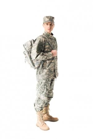 Handsome army soldier in uniform holding backpack isolated on white