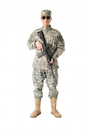 Serious army soldier with gun isolated on white