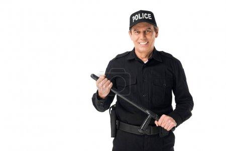Photo pour Jeune policier avec bâton regardant caméra isolé sur blanc - image libre de droit