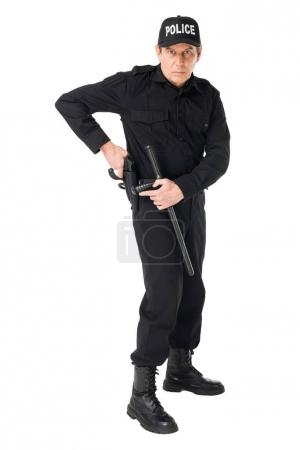 Confident policeman in uniform pulling out gun isolated on white