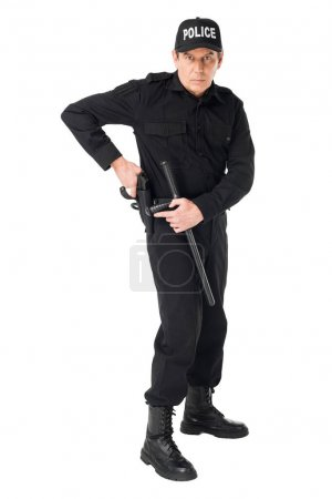 Photo pour Confiant policier en uniforme tirant des armes à feu isolé sur blanc - image libre de droit