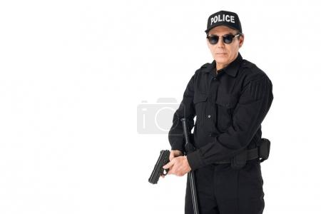 Serious policeman in sunglasses with gun isolated on white