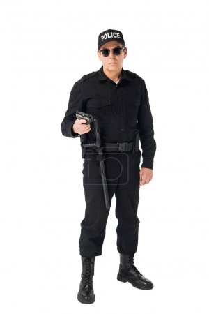 Serious policeman in sunglasses holding gun isolated on white