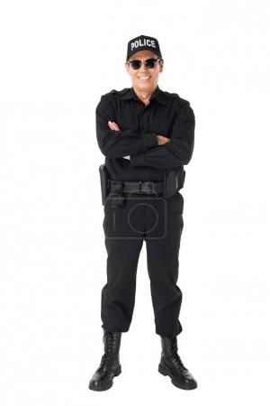 Smiling policeman with arms folded isolated on white