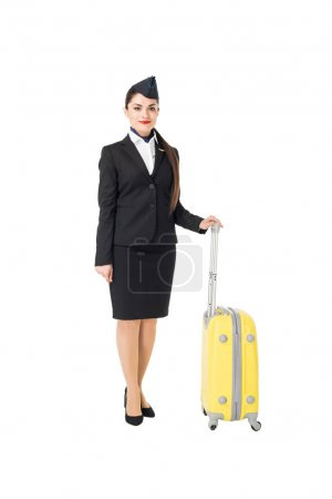 Stewardess in uniform holding suitcase isolated on white