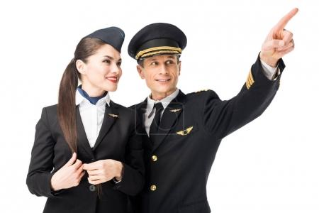 Pilot pointing showing stewardess something isolated on white