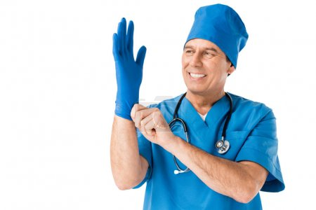 Male doctor wearing latex glove isolated on white
