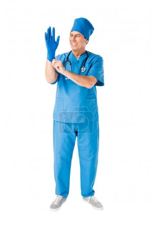 Smiling male doctor wearing medical glove isolated on white