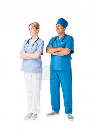 Surgeon and nurse with arms folded isolated on white