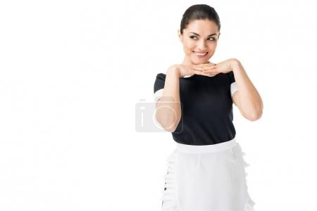 Photo pour Servante souriante en uniforme professionnel avec les mains par le visage isolé sur blanc - image libre de droit
