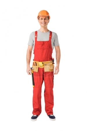 Cheerful construction worker in uniform isolated on white