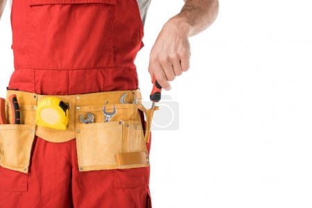 Photo for Close-up view of handyman taking tools in belt isolated on white - Royalty Free Image