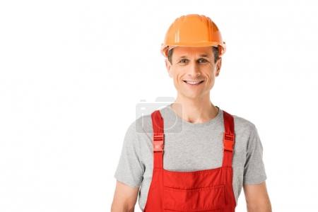 Professional builder in overalls and hardhat isolated on white