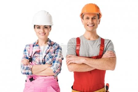 Smiling professional builders man and woman isolated on white