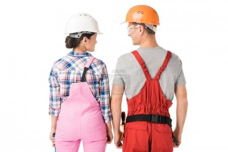 Construction workers team of man and woman in helmets isolated on white
