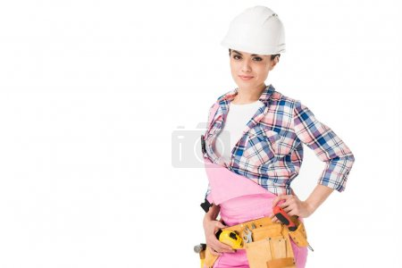 Smiling female engineer in pink overalls isolated on white