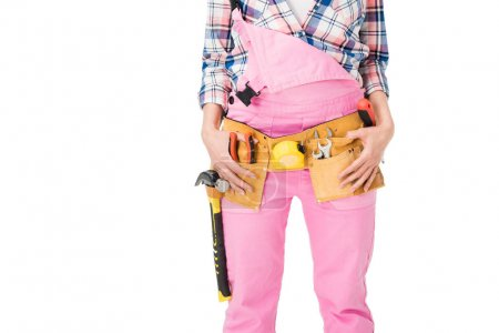 Close-up view of female builder with tools in belt isolated on white