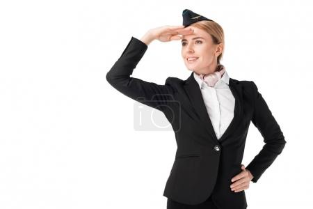 Stewardess in uniform looking away isolated on white