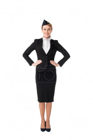 Smiling young stewardess in uniform isolated on white