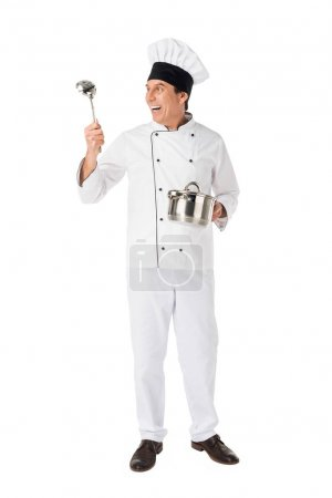 Smiling chef with pan and ladle isolated on white