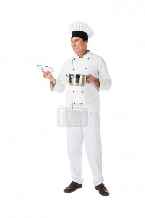 Professional cook holding pan isolated on white