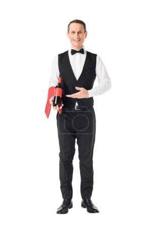 Elegant waiter showing bottle of wine isolated on white