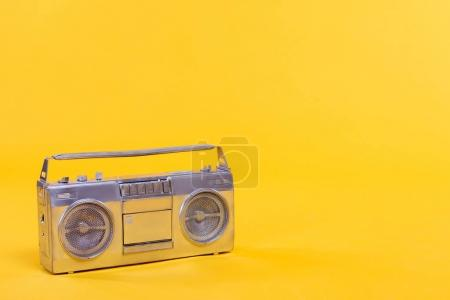 close-up view of trendy silver tape recorder isolated on yellow