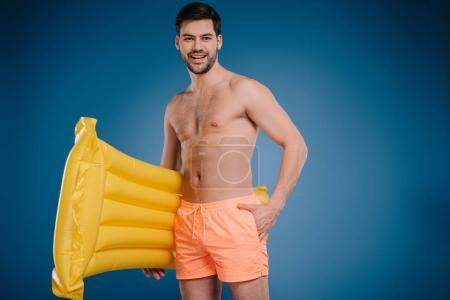 Man holding swimming mattress