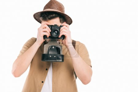 young man in hat photographer with camera isolated on white