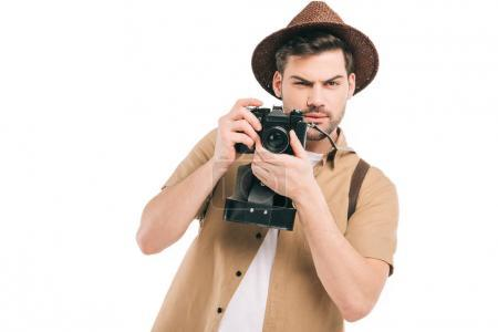 Photo for Handsome young traveler holding camera and smiling isolated on white - Royalty Free Image