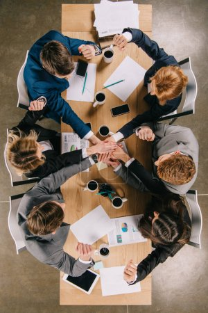 Top view of colleagues at table in office, businesspeople teamwork collaboration relation concept