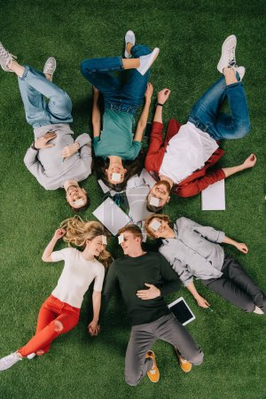 Top view of smiling businesspeople playing game called who am i