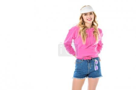 Young girl wearing pink sweatshirt and jeans shorts isolated on white