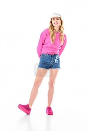 Attractive young woman dressed in pink and wearing visor isolated on white