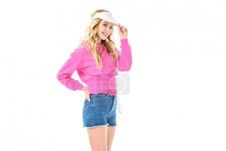 Blonde woman in pink clothes and visor isolated on white