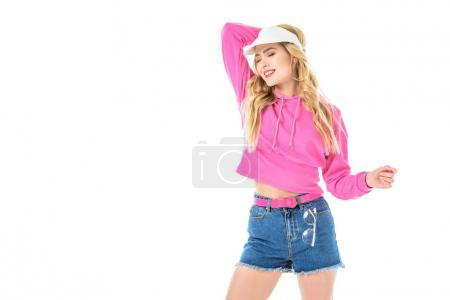 Young girl wearing pink sweatshirt and tennis cap isolated on white