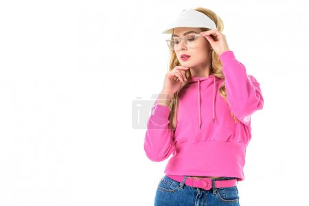 Young girl wearing pink sweatshirt and glasses isolated on white
