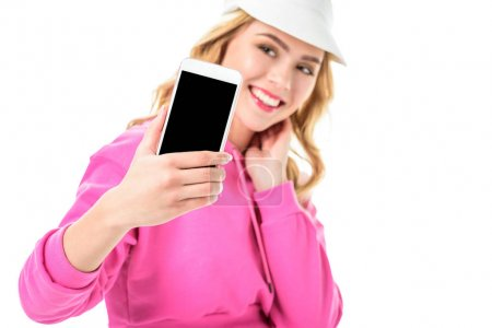 Blonde woman in pink clothes and tennis cap taking selfie isolated on white