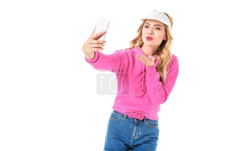 Young girl wearing pink sweatshirt taking selfie isolated on white