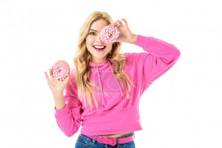 Young girl wearing pink holding doughnuts isolated on white