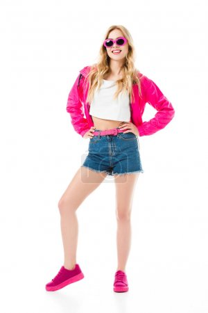 Attractive young woman dressed in pink posing isolated on white