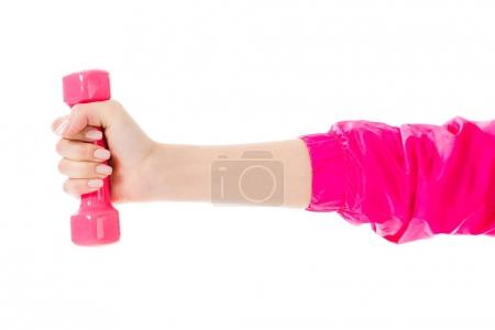 Close-up view of woman holding pink dumbbell isolated on white