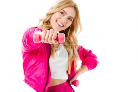 Pink dumbbells in hands of blonde woman isolated on white