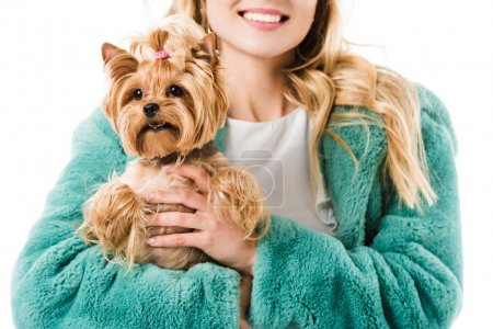 Young fashionable girl holding cute dog isolated on white