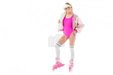 Young girl wearing pink roller skates and swimsuit isolated on white