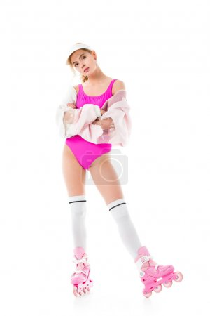 Blonde woman in pink clothes and roller skates isolated on white