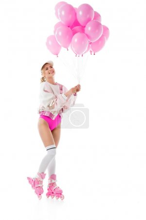 Young girl wearing pink roller blades holding balloons isolated on white