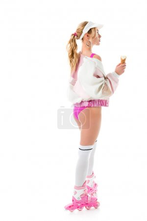 Young girl wearing pink roller skates and holding ice cream isolated on white