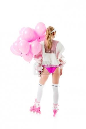 Blonde woman in pink clothes and roller skates holding balloons isolated on white