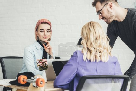 selective focus of young creative workers working on new idea in office